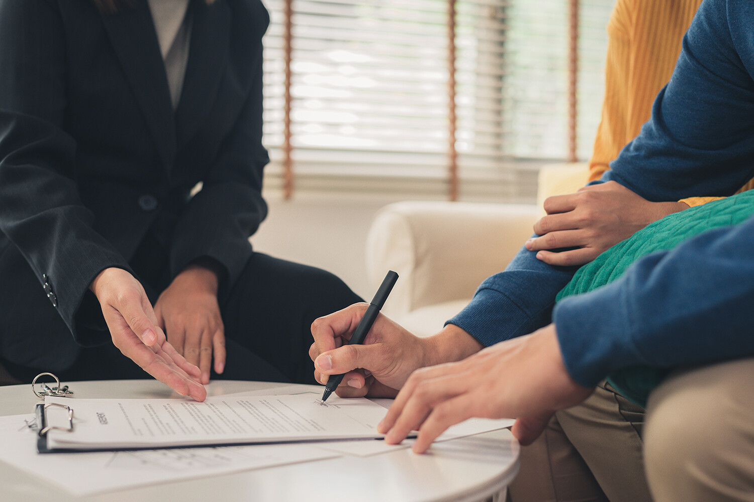 Two people signing insurance policy
