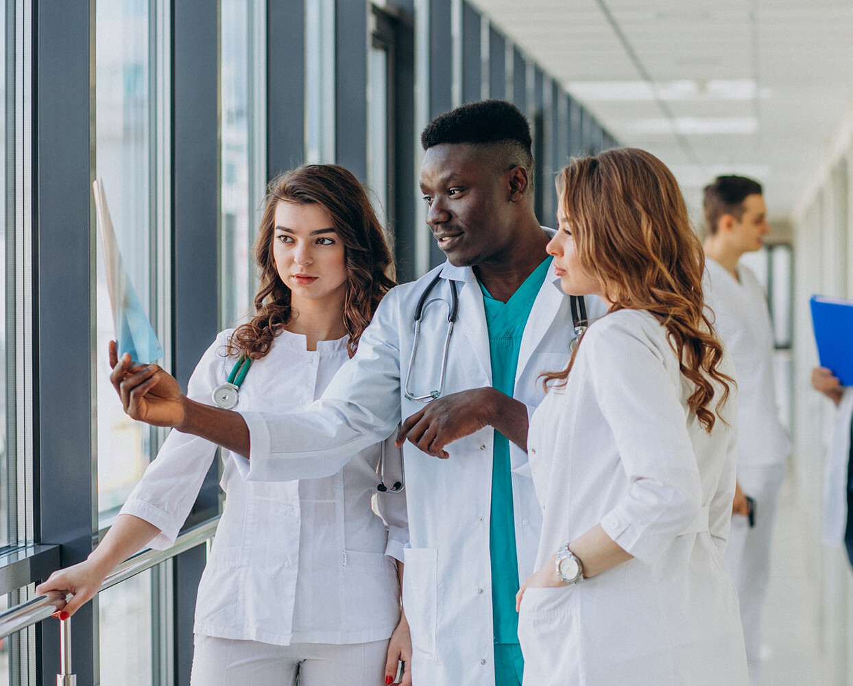 Surgeons looking at xrays