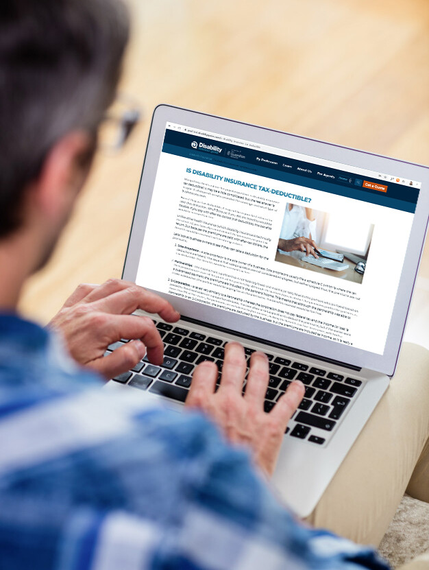 Man on laptop looking at Disability Insurance Quotes