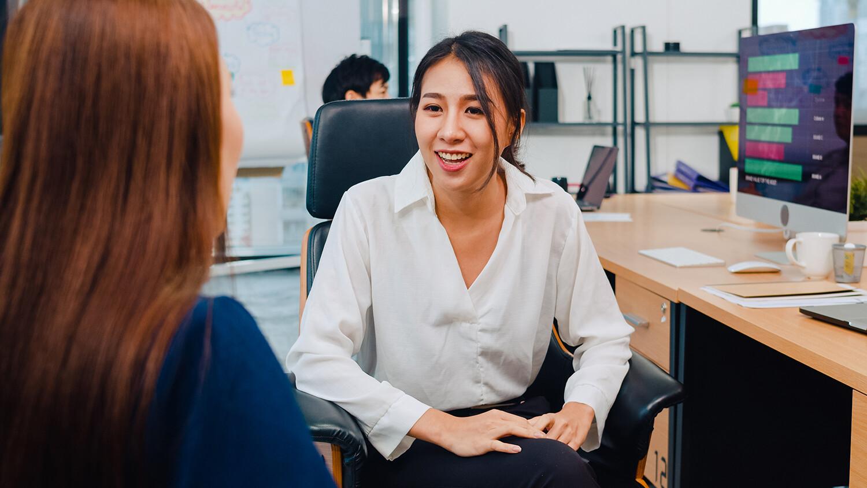 Women Chatting at Work