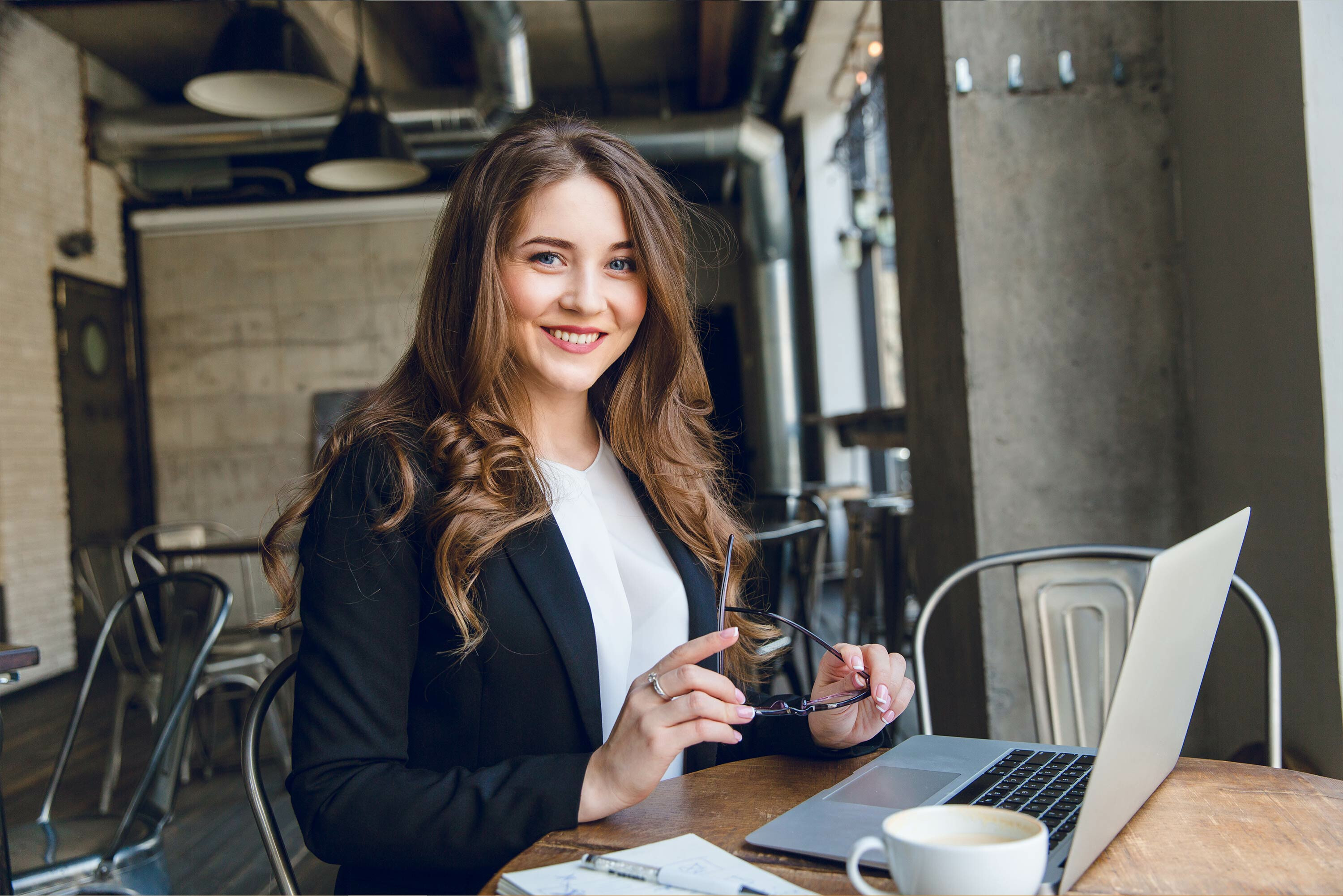 woman business owner smiling