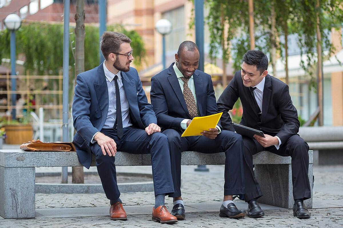 3 executives talking