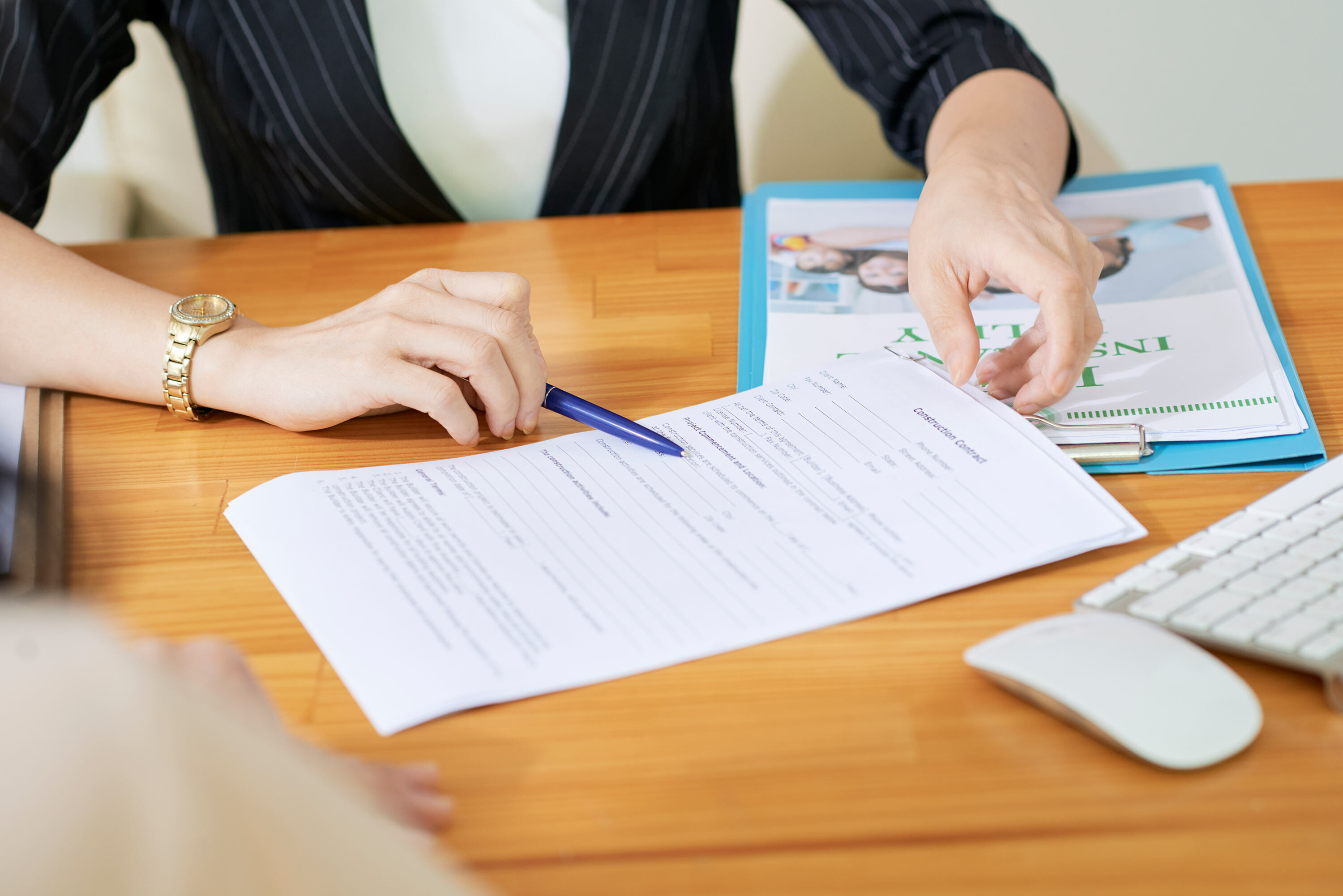woman with disability insurance policy on table