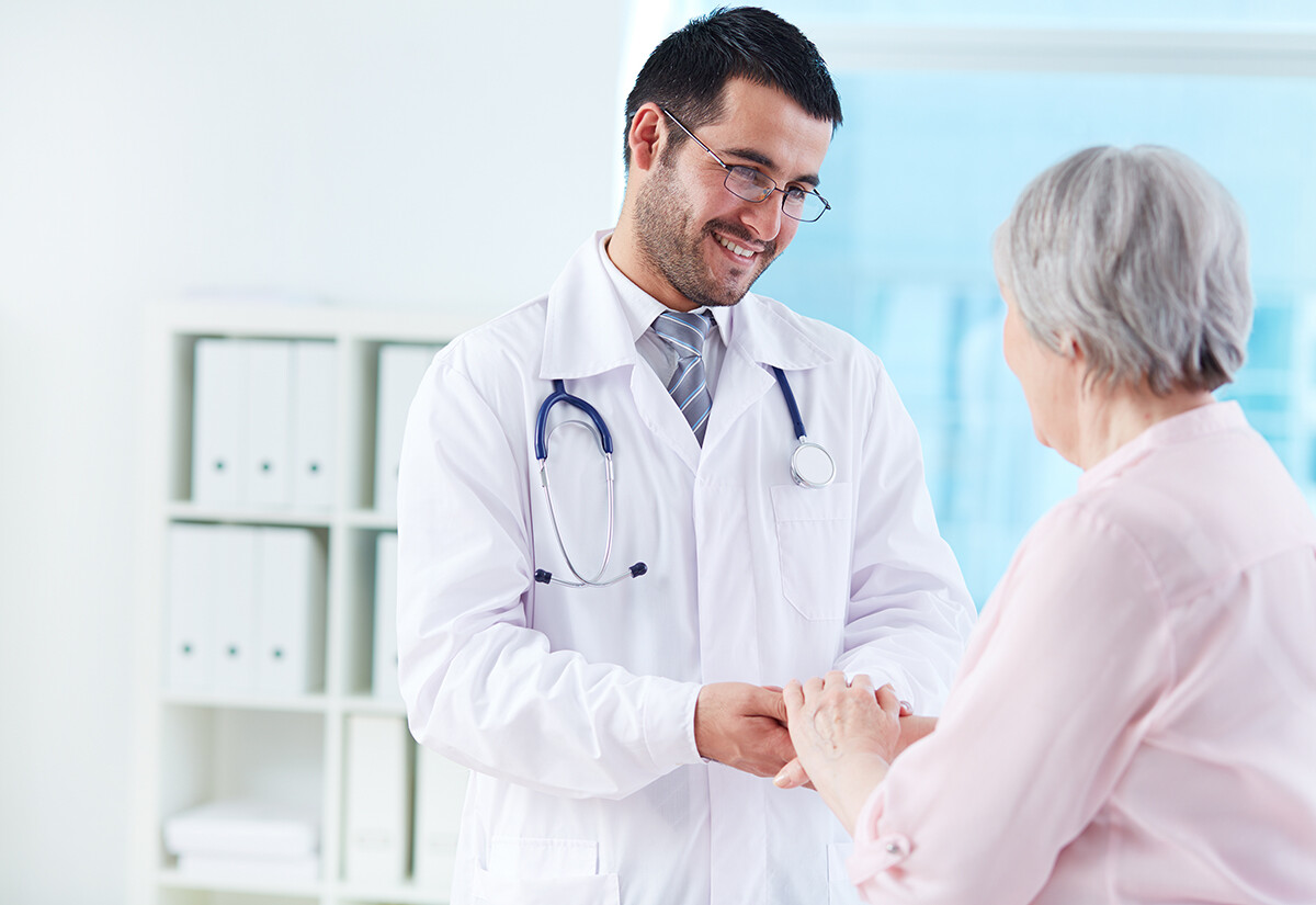 Physician with older patient