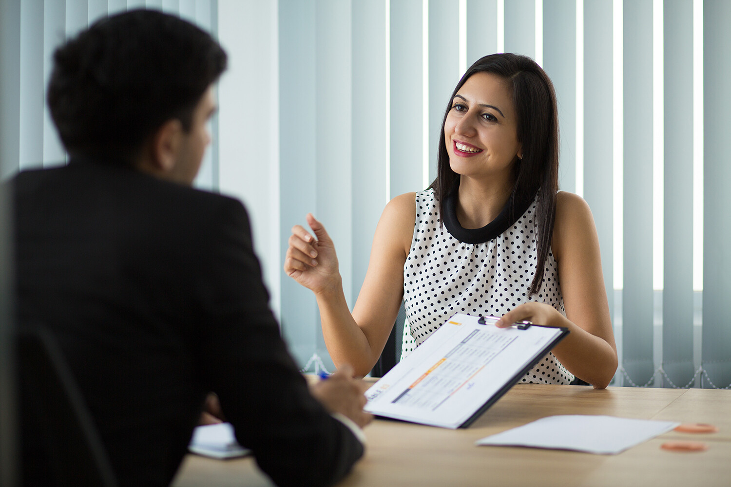 Female insurance agent in meeting